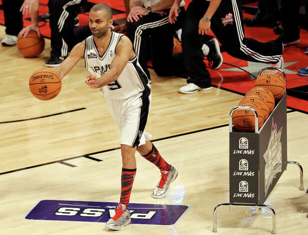 San Antonio Spurs' Tony Parker passes during the Taco Bell Skills Challenge at the Toyota Center Saturday, Feb. 16, 2013, in Houston. Photo: Edward A. Ornelas, San Antonio Express-News / © 2013 San Antonio Express-News