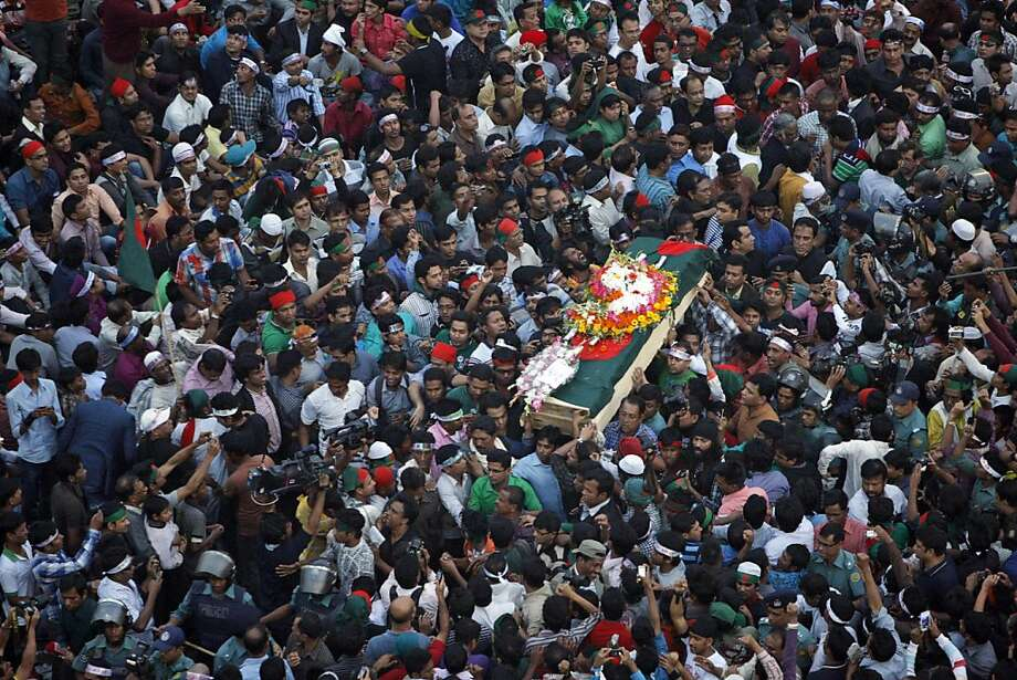 Bangladeshi mourners carry the coffin containing the body of blogger Rajib Haider, 30, for funeral in Dhaka, Bangladesh, Saturday, Feb. 16, 2013. Haidar had been critical of the Islamic group Jamaat-e-Islami, whose leader Abdul Quader Mollah was recently given a life sentence for his role in the killing of 381 civilians during the nation's 1971 war for independence from Pakistan. Thousands of university students and other activists demanding his execution have accused the fundamentalist party of killing Haider last evening while he was returning home, according to news reports. Photo: Pavel Rahman, Associated Press
