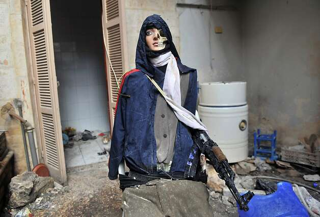 A dummy is displayed in a flat used by rebel fighter to fight against Syrian government forces in the Salaheddine neighborhood of Aleppo on February 16, 2013. More than 300 people were abducted by armed groups in northwestern Syria over two days in an unprecedented string of sectarian kidnappings, a watchdog and residents said. Photo: Bulent Kilic, AFP/Getty Images