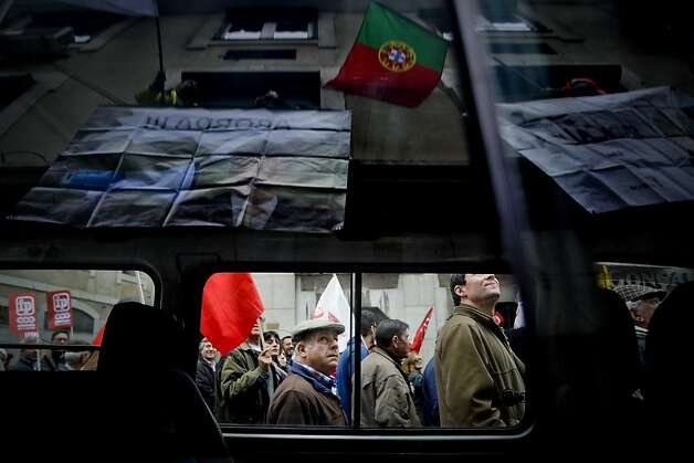 People attend a demonstration organized by Portugal's biggest trade union CGTP (Portuguese General Workers Confederation)  against government austerity measures in Lisbon, on February 16, 2013.  Photo: Patricia De Melo Moreira, AFP/Getty Images