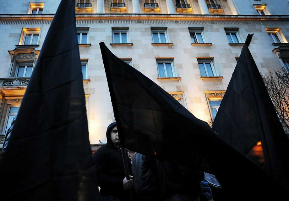 Members of nationalist organizations wave black flags in central Sofia on February 16, 2013. More than one thousand members of various nationalist organizations marched to commemorate General Hristo Lukov, a Bulgarian army commander from the World War I, who was killed on February 13, 1943.  Photo: Nikolay Doychinov, AFP/Getty Images