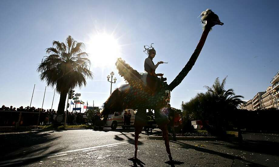 """A reveler parades during the flower parade of the 129th edition of the Nice Carnival, Saturday, Feb. 16, 2013, in Nice, southern France. The carnival celebrates the theme """"King of the 5 continents"""".  Photo: Lionel Cironneau, Associated Press"""