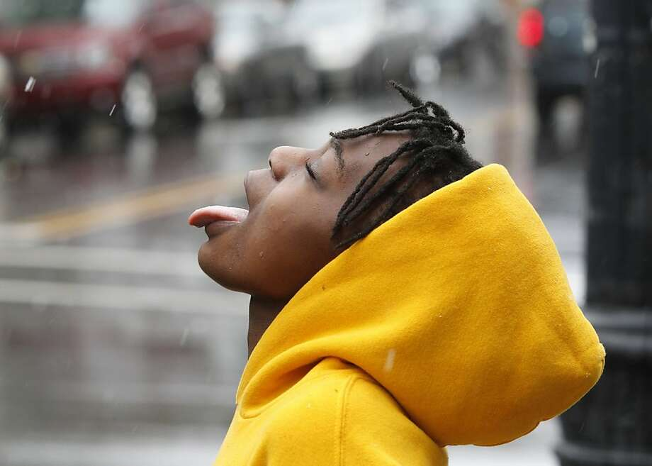 Raeyonna Morgan catches snowflakes on her tongue as snow falls in downtown Raleigh, North Carolina, Saturday, February 16, 2013.  Photo: Ethan Hyman, McClatchy-Tribune News Service