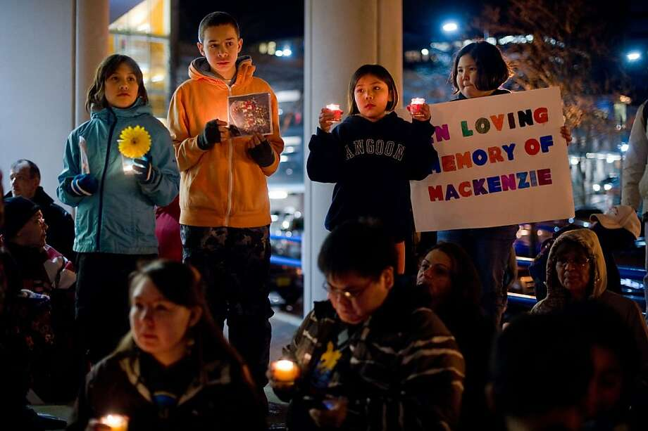 Aja Marks, 9, left, Brandon Chilton, 13, Leona Demmert, 8, and Lilliana Demmert, 10, attend a candlelight vigil in honor of 13-year-old Mackenzie Howard at the Sealaska Plaza in Juneau, Alaska, on Feb. 8, 2013. Howard's body was found inside a Kake, Alaska, church.  Photo: Michael Penn, Associated Press