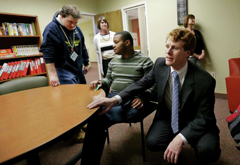 U.S. Rep. Joseph Kennedy III, D-Mass., greets people in the lounge of the Seven Hills Foundation's new facility in Milford, Mass. Seven Hills features the ASPIRE! program for people with developmental disabilities. Photo: Elise Amendola, STF / AP