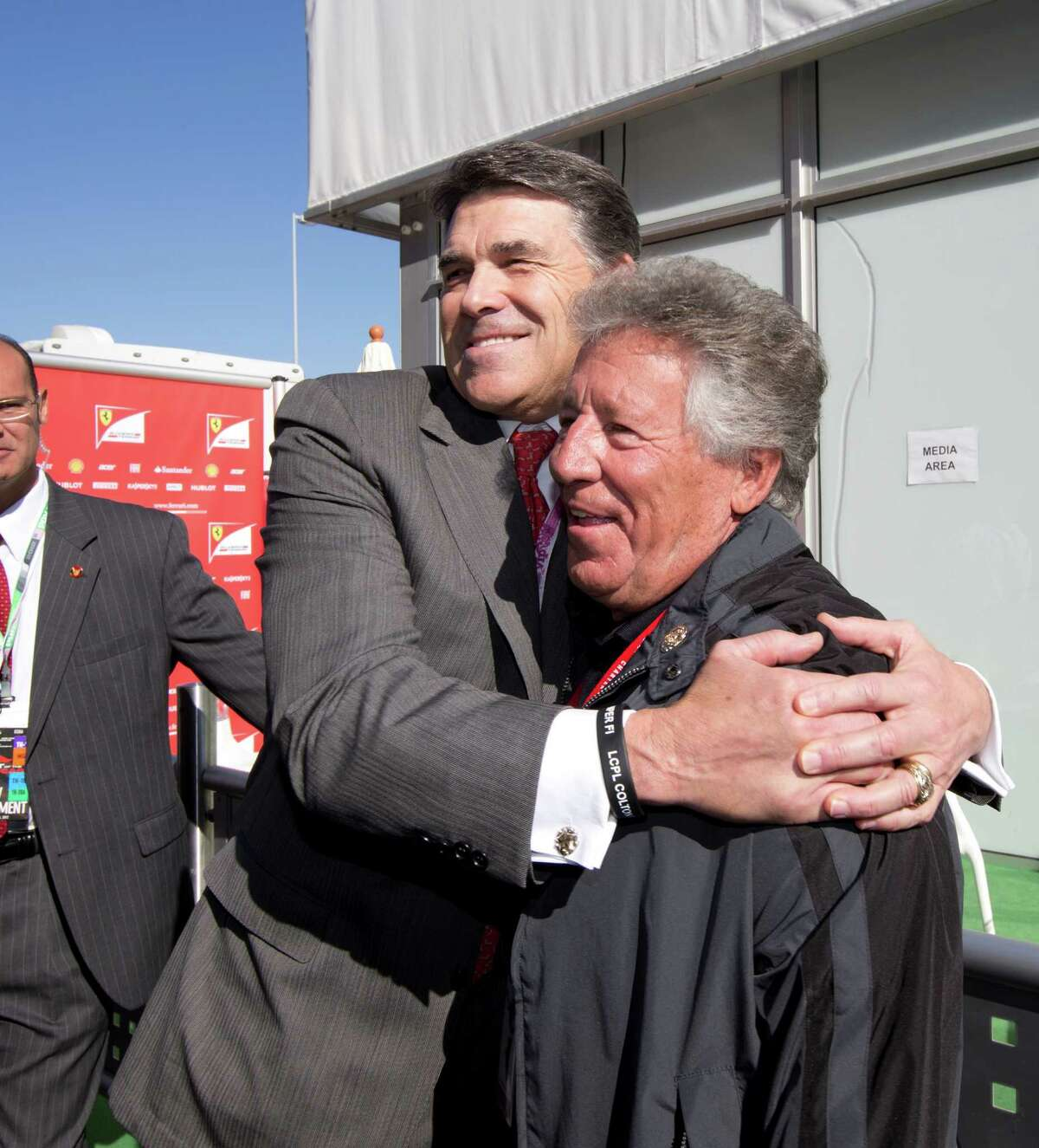 Gov. Rick Perry, left, was on hand last November at the inaugural United States Grand Prix in Austin to greet VIPs such as legendary driver Mario Andretti.