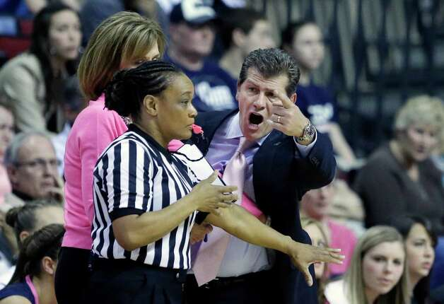 Connecticut head coach Geno Auriemma disputes a call with official Norma Jones  during the first half of an NCAA college basketball game against Rutgers on Saturday, Feb. 16, 2013, in Piscataway, N.J. Connecticut won 65-45. (AP Photo/Mel Evans) Photo: Mel Evans, Associated Press / AP