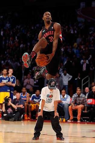 Slam dunk contest winner Terrence Ross of the Toronto Raptors jumps over a youngster in the championship round. Photo: Scott Halleran, Getty Images