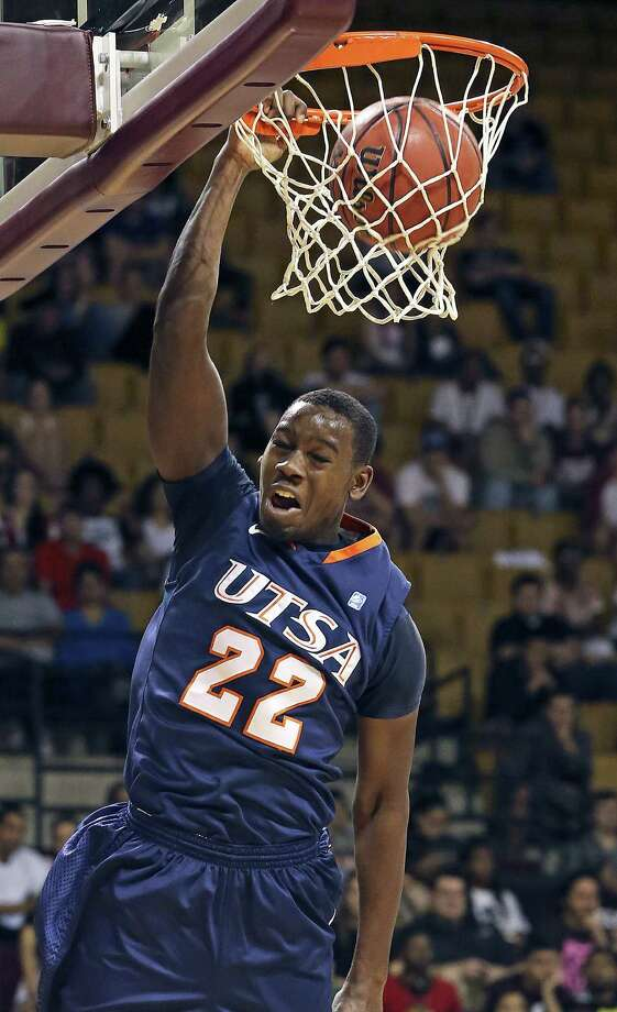 UTSA's Kannon Burrage throws down a dunk during the first half of Saturday's game against Texas State in San Marcos. Burrage finished with a team-high 15 points and seven rebounds. Photo: Tom Reel /