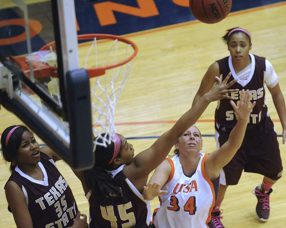 UTSA's Lyndi Thorman tries to float a left-handed shot over Texas State's Ashley Ezeh during Saturday's Western Athletic Conference game at the Convocation Center. Photo: Billy Calzada / San Antonio Express-News