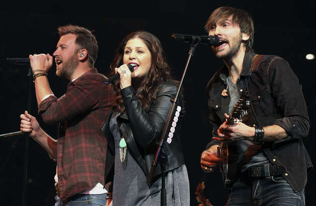 Lady Antebellum's Charley Kelley (from left), Hilary Scott and Dave Haywood sing at the San Antonio Stock Show & Rodeo. Photo: Kin Man Hui / San Antonio Express-News