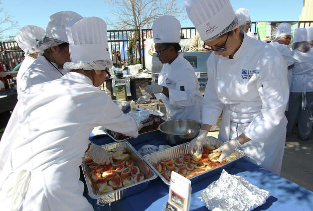 Culinary students from St. Philips College prepare an appetizer of crostini to be paired with a wine at the H-E-B Wine Garden at the San Antonio Stock Show and Rodeo on Saturday, Feb. 16, 2013. Photo: Kin Man Hui, San Antonio Express-News / © 2012 San Antonio Express-News