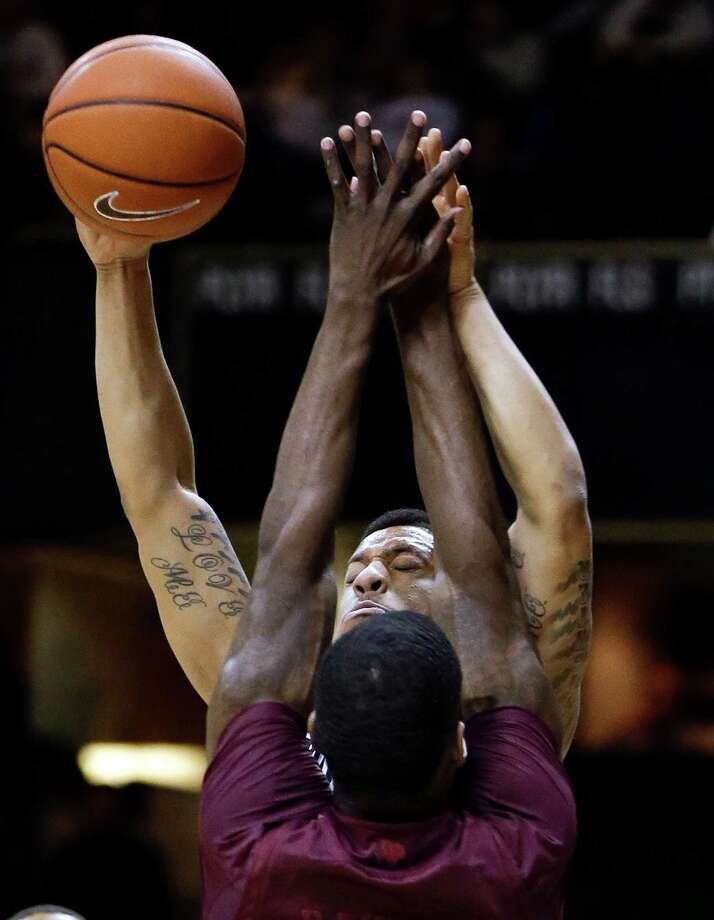 Vanderbilt guard Kyle Fuller, top, runs into Texas A&M forward Ray Turner, bottom, in the first half of an NCAA college basketball game on Saturday, Feb. 16, 2013, in Nashville, Tenn. (AP Photo/Mark Humphrey) Photo: Mark Humphrey, Associated Press / AP