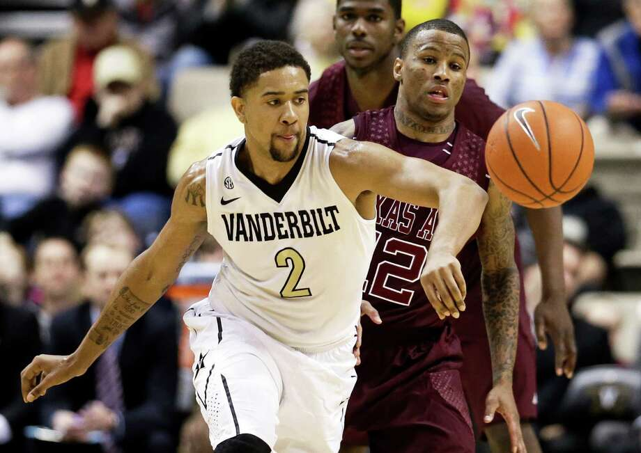 Vanderbilt guard Kedren Johnson (2) and Texas A&M guard Fabyon Harris (12) chase down a loose ball in the first half of an NCAA college basketball game on Saturday, Feb. 16, 2013, in Nashville, Tenn. (AP Photo/Mark Humphrey) Photo: Mark Humphrey, Associated Press / AP