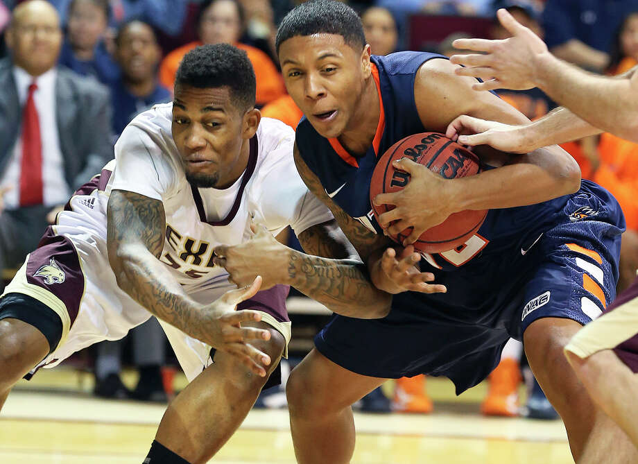 Roadrunner forward Jordan Sims protects the ball as Joel Wright sneaks in to try a steal in a second half Bobcat comeback as Texas State hosts UTSA in men's basketball at Strahan Coliseum  on February 16, 2013. Photo: Tom Reel, San Antonio Express-News
