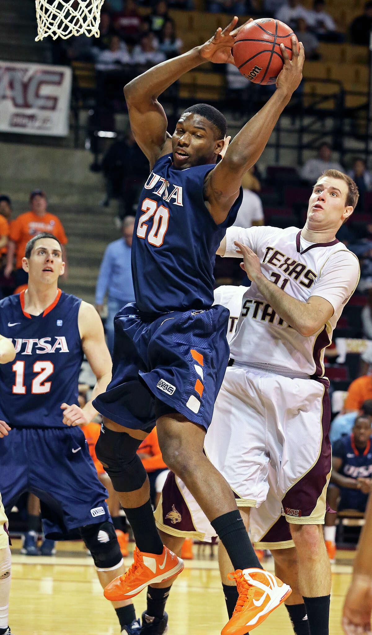 UTSA center Edrico McGregor rips away a rebound in front of Matt Staff as Texas State hosts UTSA in men's basketball at Strahan Coliseum on February 16, 2013.