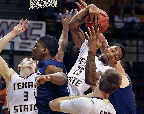 Bobcat forward Joel Wright tears a rebound out of a crowd as Texas State hosts UTSA in men's basketball at Strahan Coliseum  on February 16, 2013. Photo: Tom Reel, San Antonio Express-News