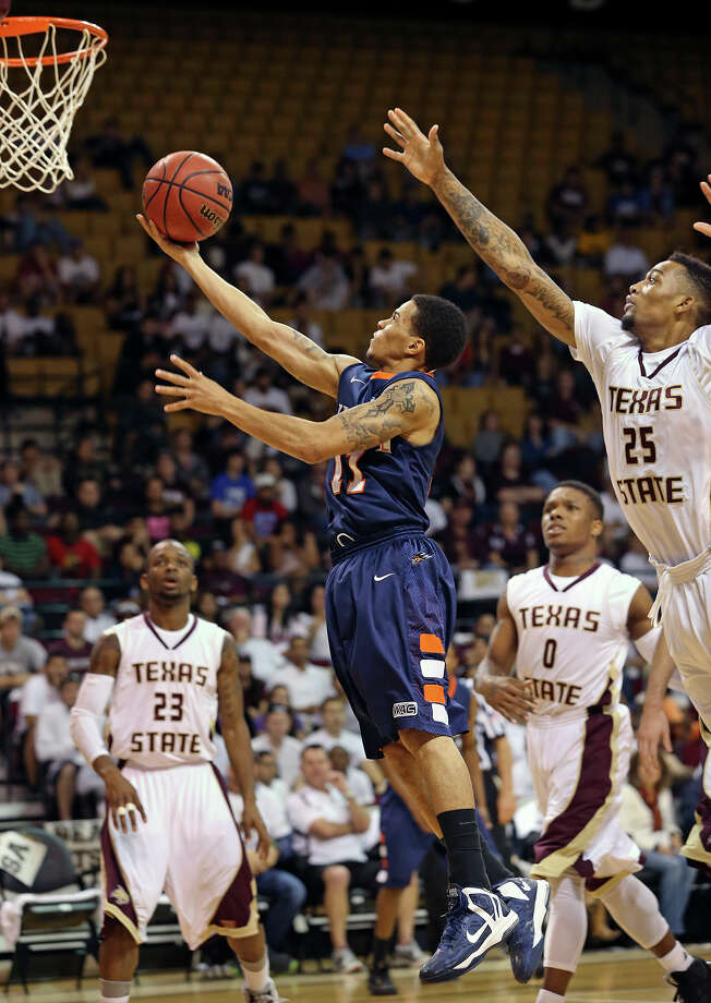 Runners guard Michael Hale takes command in the first half by splitting the defense and getting to the bucket as Texas State hosts UTSA in men's basketball at Strahan Coliseum  on February 16, 2013. Photo: Tom Reel, San Antonio Express-News