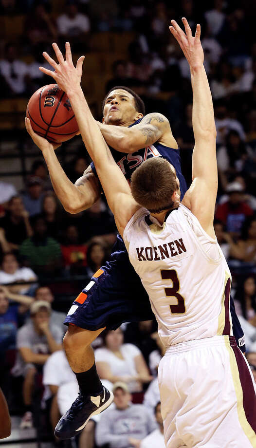 Roadrunner point guard Michael Hale draws a foul off Reid Koenen on a fast break as Texas State hosts UTSA in men's basketball at Strahan Coliseum  on February 16, 2013. Photo: Tom Reel, San Antonio Express-News
