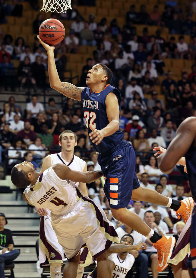 Jordan Sims draws a blocking foul from the Bobcats' Ray Dorsey as Texas State hosts UTSA in men's basketball at Strahan Coliseum  on February 16, 2013. Photo: Tom Reel, San Antonio Express-News