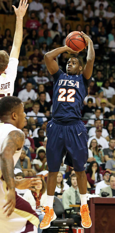 Kannon Burrage pumps for the Roadrunners as Texas State hosts UTSA in men's basketball at Strahan Coliseum  on February 16, 2013. Photo: Tom Reel, San Antonio Express-News