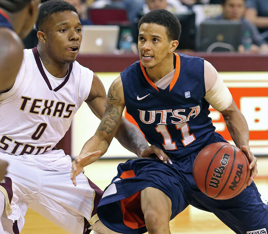 Runner guard Michael Hale plays in the second half with an arm bandage against Phil Hawkins as Texas State hosts UTSA in men's basketball at Strahan Coliseum  on February 16, 2013. Photo: Tom Reel, San Antonio Express-News