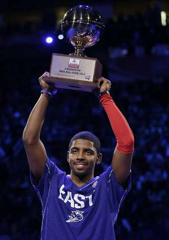 Kyrie Irving of the Cleveland Cavaliers holds up the trophy after winning the 3-point contest during NBA basketball All-Star Saturday Night, Feb. 16, 2013, in Houston. (AP Photo/Eric Gay) Photo: Eric Gay, Associated Press