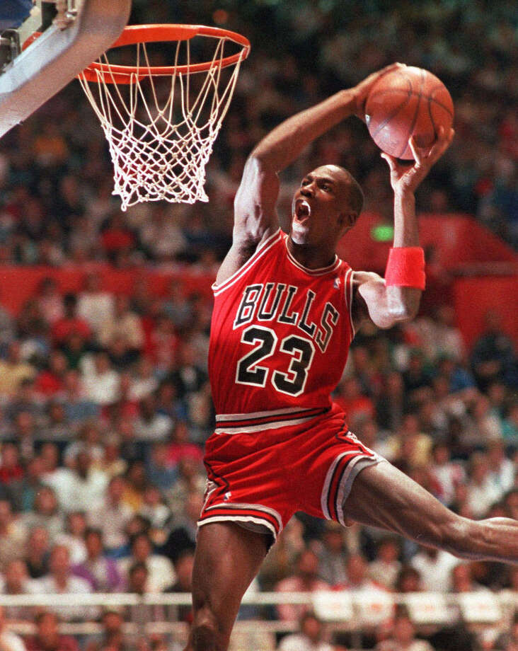 Chicago Bulls' Michael Jordan takes part in the NBA All-Star Slam Dunk contest in Seattle in this Feb. 7, 1987 photo. Photo: KIRTHMON DOZIER, AP / AP