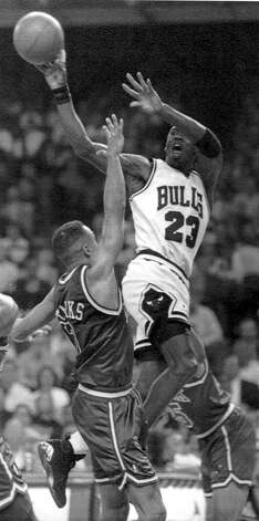 Michael Jordan of the Chicago Bulls shoots over New York Knicks' John Starks in the third quarter of Game 4 of the Eastern Conference finals in Chicago on May 31, 1993. In a commanding display, Jordan scored 54 points, leading the Bulls to 105-95 victory over the Knicks. Photo: Fred Jewell, ASSOCIATED PRESS