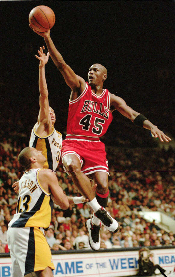 Chicago Bulls guard Michael Jordan flies to the hoop over the Indiana Pacers' Reggie Miller and Mark Jackson (13), March 19, 1995, in Indianapolis, Ind. Photo: MICHAEL CONROY, AP / AP
