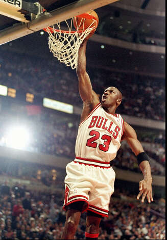 Guard Michael Jordan of the Chicago Bulls goes up for two during a game against the Atlanta Hawks at the United Center in Chicago on Feb. 13, 1998. The Bulls defeated the Hawks 112-110. Photo: Jonathan Daniel, Getty Images / 1990 Getty Images