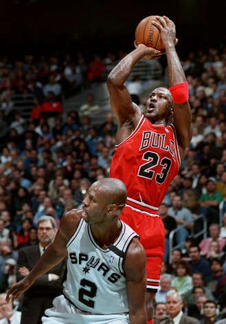 After turning Spurs Jaren Jackson around, the Bulls Michael Jordan hits a jumper during first half at the Alamodome on March 14, 1998. Photo: DOUG SEHRES, SAN ANTONIO EXPRESS-NEWS / SAN ANTONIO EXPRESS-NEWS