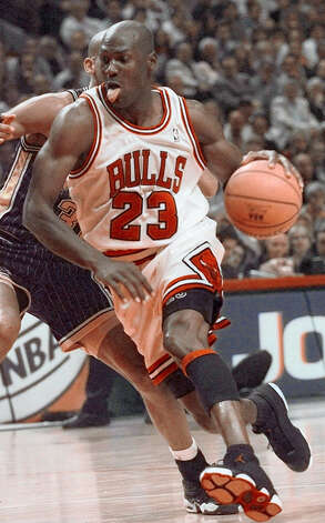 Chicago Bulls' Michael Jordan drives past Indiana Pacers' Reggie Miller during Game 5 of the Eastern Conference Finals in Chicago, in this May 27, 1998 photo. Photo: BETH A. KEISER, AP / AP