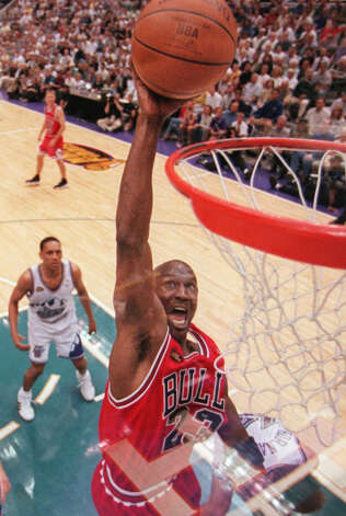 Chicago Bulls' Michael Jordan goes to the basket in the third quarter as Utah Jazz's Howard Eisley looks on during Game 2 of the NBA Finals in Salt Lake City, Friday, June 5, 1998. Photo: MARK J. TERRILL, AP / AP