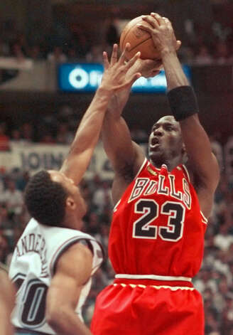 Chicago Bulls' Michael Jordan (23) shoots over Utah Jazz's Shandon Anderson in the first half of Game 6 of the NBA Finals in Salt Lake City, Sunday, June 14, 1998. Photo: MARK J. TERRILL, AP / AP