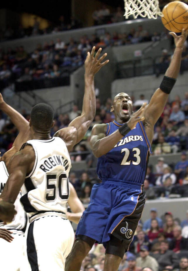 Washington Wizards guard Michael Jordan (23) shoots around San Antonio Spurs center David Robinson (50) during the first quarter in San Antonio, Dec. 21, 2002. Photo: ERIC GAY, AP / AP