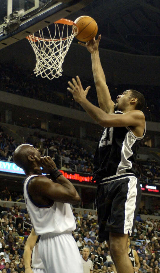 San Antonio Spurs' Tim Duncan (21) shoots over Washington Wizards' Michael Jordan, left, during the second quarter, Tuesday, Dec. 31, 2002, in Washington. Photo: NICK WASS, AP / AP
