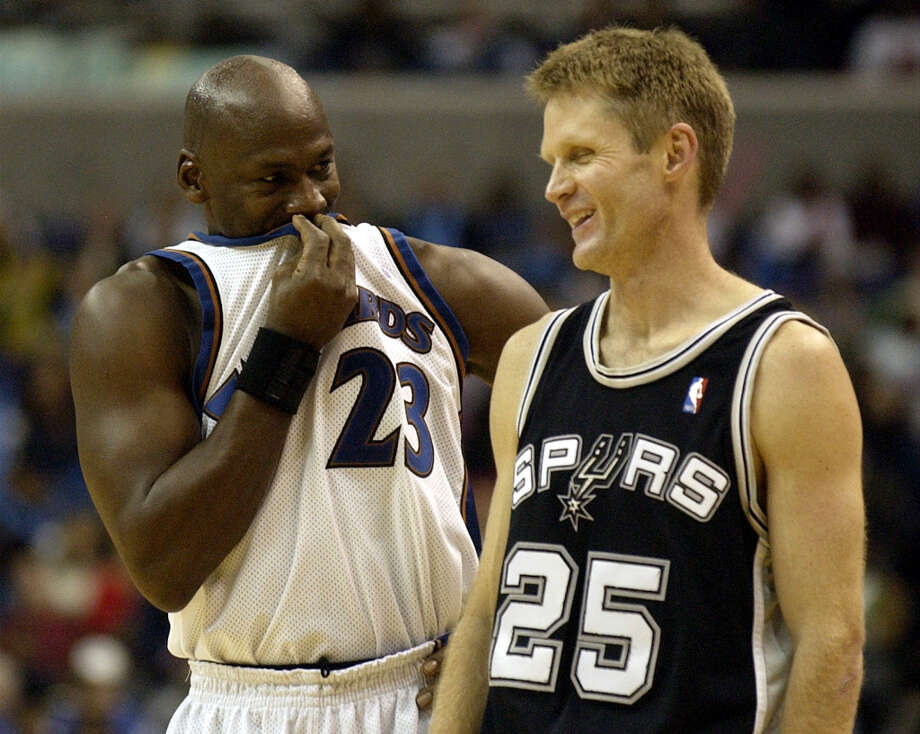 Washington Wizards' Michael Jordan (23) shares a laugh with San Antonio Spurs' Steve Kerr (25) during the second half of the Wizards' 105-103 win, Tuesday, Dec. 31, 2002, in Washington. Photo: NICK WASS, AP / AP