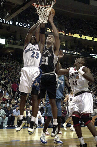 Spurs Tim Duncan (21) squeezes out Washington Wizards' Michael Jordan (23) and Philadelphia 76ers Dikembe Mutombo (55) for a rebound during the 2002 NBA All-Star Game and the Union Center in Philadelphia on Sunday, Feb. 10, 2002. Photo: KIN MAN HUI, SAN ANTONIO EXPRESS-NEWS / SAN ANTONIO EXPRESS-NEWS