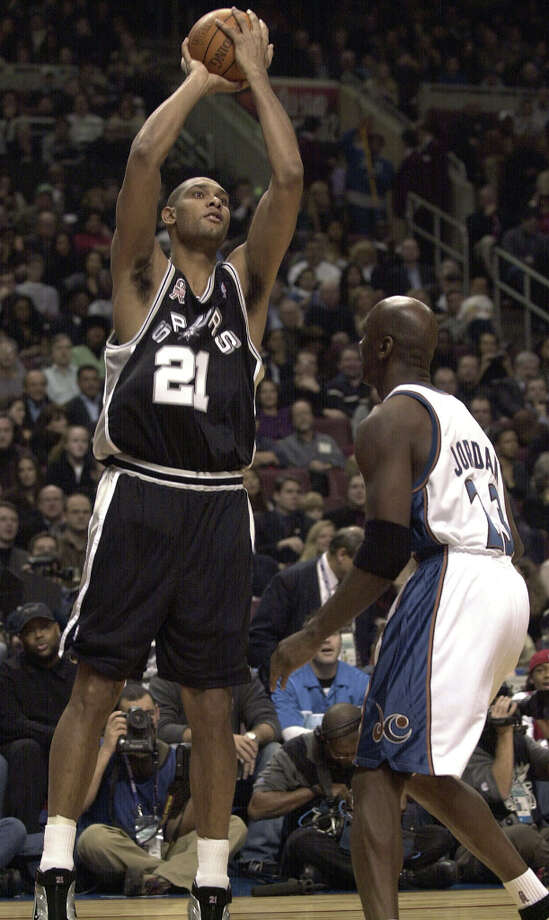 Spurs Tim Duncan (21) shoots over Washington Wizards' Michael Jordan (23) during the 2002 NBA All-Star Game and the Union Center in Philadelphia on Sunday, Feb. 10, 2002. Photo: KIN MAN HUI, SAN ANTONIO