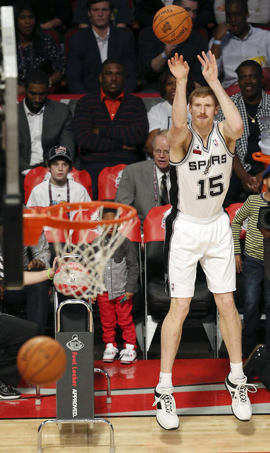 Matt Bonner shoots during the 3-point contest at the Toyota Center in Houston. He lost 23-20 in the finals to Cleveland guard Kyrie Irving. Photo: Edward A. Ornelas / Express-News
