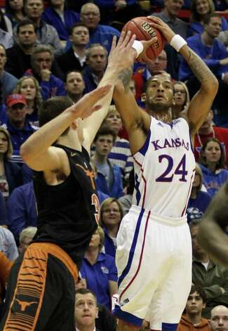 Kansas' Travis Releford (24) shoots over Texas Ioannis Papapetrou during the first half of an NCAA college basketball game on Saturday, Feb. 16, 2013, in Lawrence, Kan. (AP Photo/Ed Zurga) Photo: Ed Zurga, Associated Press / FR34145 AP