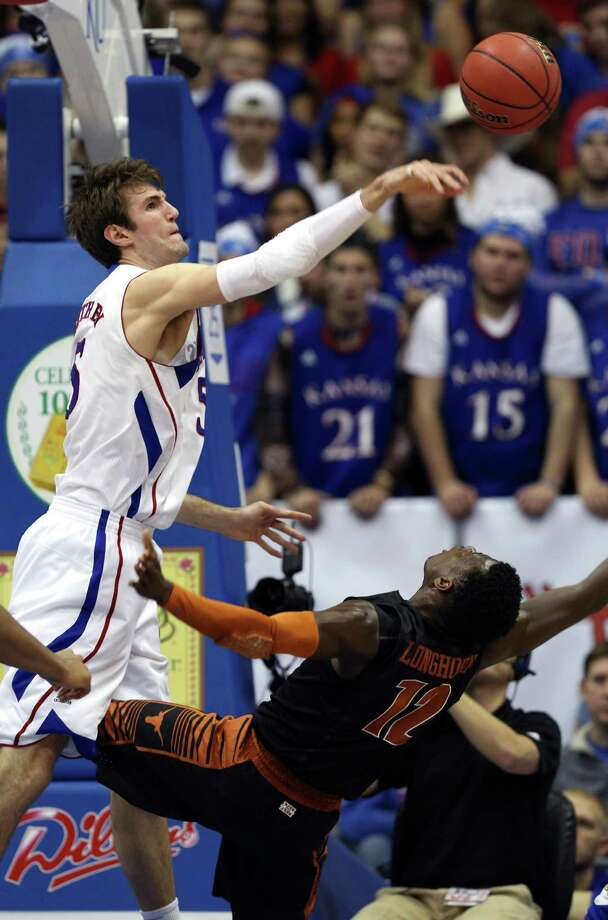 Kansas' Jeff Withey (5) blocks a shot by Texas' Myck Kabongo (12) during the first half of an NCAA college basketball game on Saturday, Feb. 16, 2013, in Lawrence, Kan. Kansas won 73-47. (AP Photo/Ed Zurga) Photo: Ed Zurga, Associated Press / FR34145 AP