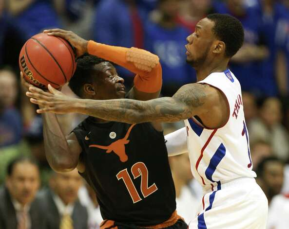 Texas guard Myck Kabongo (12) looks to pass around Kansas uard Naadir Tharpe during the first half of an NCAA college basketball game on Saturday, Feb. 16, 2013, in Lawrence, Kan. (AP Photo/Ed Zurga) Photo: Ed Zurga, Associated Press / FR34145 AP
