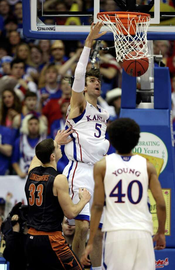 Kansas' Jeff Withey (5) dunks the ball past Texas' Ioannis Papapetrou (33) during the second half of an NCAA college basketball game Saturday, Feb. 16, 2013, in Lawrence, Kan. Kansas won 73-47. (AP Photo/Ed Zurga) Photo: Ed Zurga, Associated Press / FR34145 AP