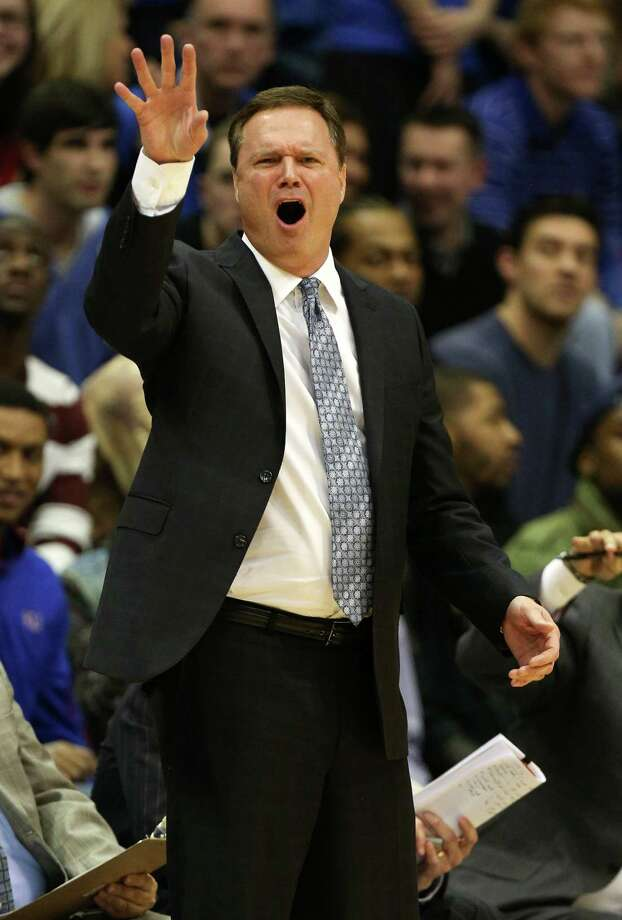 Kansas head coach Bill Self calls out plays to his players during the first half of an NCAA college basketball game against Texas, Saturday, Feb. 16, 2013, in Lawrence, Kan. Kansas won 73-47. (AP Photo/Ed Zurga) Photo: Ed Zurga, Associated Press / FR34145 AP