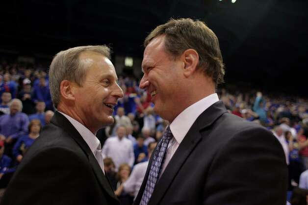 Texas head coach Rick Barnes, left, and Kansas head coach Bill Self talk at the end of Kansas' 73-47 win over Texas in an NCAA college basketball game in Lawrence, Kan., Saturday, Feb. 16, 2013. (AP Photo/The Daily Texan, Lawrence Peart) Photo: Lawrence Peart, Associated Press / The Daily Texan