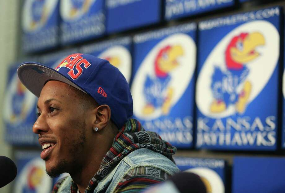 Former Kansas player Mario Chalmers and current member of the Miami Heat talks to the media prior to a Kansas college basketball game against Texas,Saturday, Feb. 16, 2013, in Lawrence, Kan. Chalmers' jersey is to be retired during halftime at the game. (AP Photo/Ed Zurga) Photo: Ed Zurga, Associated Press / FR34145 AP