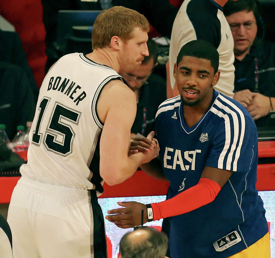 San Antonio Spurs' Matt Bonner and Cleveland Cavaliers' Kyrie Irving shake hands after the Foot Locker Three-Point Contest at the Toyota Center Saturday, Feb. 16, 2013, in Houston. Photo: Edward A. Ornelas, San Antonio Express-News / © 2013 San Antonio Express-News