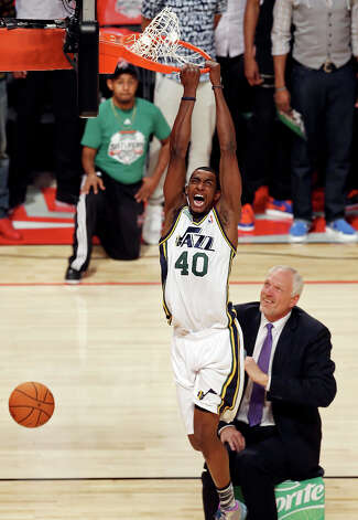 Utah Jazz's Jeremy Evans dunks over former Utah Jazz's Mark Eaton during the Sprite Slam Dunk Contest at the Toyota Center Saturday, Feb. 16, 2013, in Houston. Photo: Edward A. Ornelas, San Antonio Express-News / © 2013 San Antonio Express-News